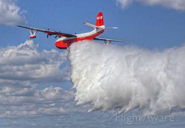 MARTIN Mars (C-FLYL) - Hawaii Mars demonstrating a water drop at the EAA seaplane base near Oshkosh, Wisconsin during AirVenture 2016.