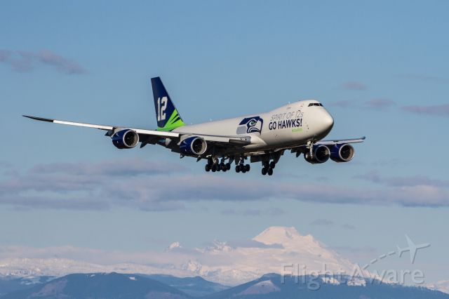 Boeing 747-200 (N770BA) - On return from a Seattle Seahawks Super Bowl victory parade fly-over of CenturyLink Field. Great sunny weather and an approach from the north end of KPAE makes for a nice shot.