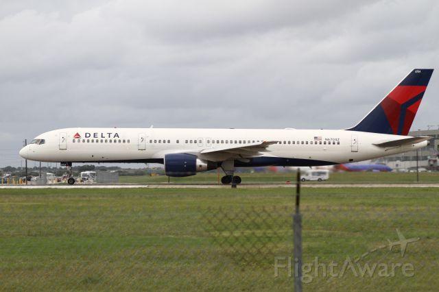Boeing 757-200 (N6704Z) - Delta's daily 757 flight departs KAUS 10 minutes behind schedule.