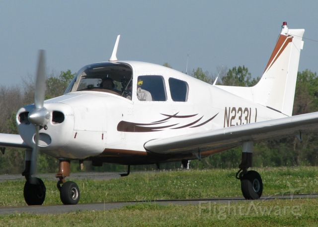 Beechcraft Sundowner (N2331J) - Taxiing to runway 14 on taxiway Foxtrot at the Shreveport Downtown airport.