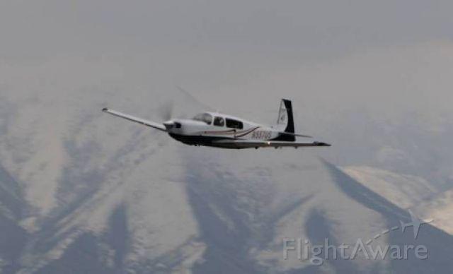 Mooney M-20 Turbo (N557US) - Fly by Mooney Bravo GX