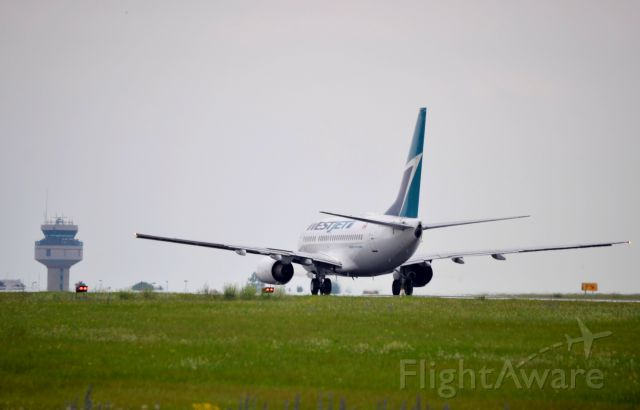 BOEING 737-600 (C-GWSK) - Heading for Torontos Pearson Airport.