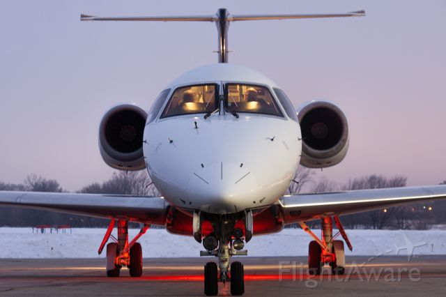 Embraer ERJ-135 (N135SX) - A beautiful Ultimate Air Shuttle E135 just at the turn of dusk about to leave Ames Municipal with the Iowa State woman's basketball team. This was my first time spotting at Ames Muni and I defiantly would do it again! Shot at 83mm, f/5, 160 ISO.