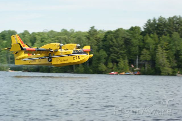 Canadair CL-41 Tutor (C-GOGX) - Crystal Lake, Ontario taken from our boat we had an awesome view as two SuperScoopers fought a nearby forest fire we could not see.