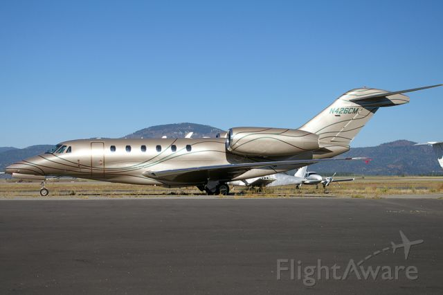 Cessna Citation X (N426CM) - Illuminated by the early morning sun is N426CM as seen at KCOE.