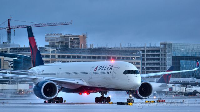 Airbus A350-900 (N506DN) - Delta A350 taxing into a snowy MSP from Seoul.
