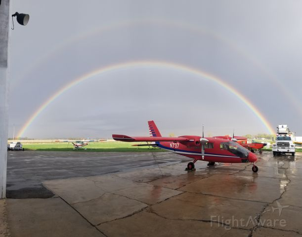 PARTENAVIA Spartacus (N737) - After a small shower N737 (US department of the interior) sits under a rainbow.