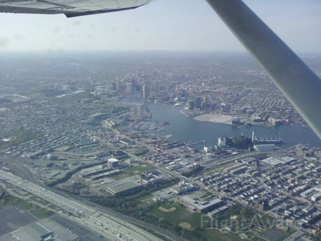 Cessna Commuter (N18167) - Departing KBWI via Runway 33R to the east over Baltimore.