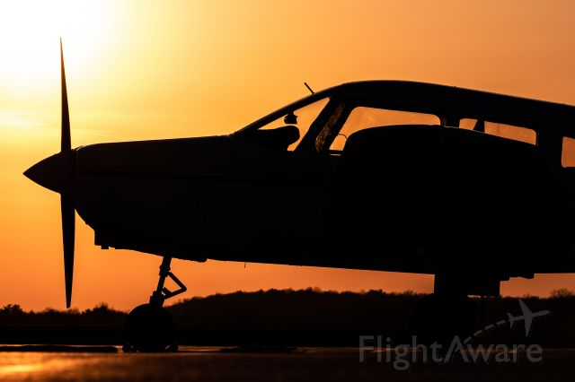 Piper Cherokee (N3033T) - One of the Purdue Pilots Inc. Pipers resting on the ramp during a serene spring sunset.