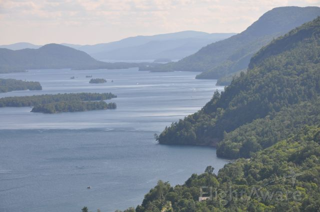 Cessna Skylane (N226SM) - Extended downwind Rnwy 02, 4B6, Ticonderoga Goat Trail, over Lake George in the Adirondacks.  I soloed here many moons ago.  A rough place to beat!