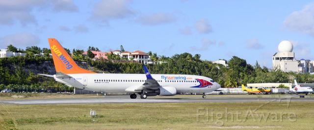 Boeing 737-800 (C-GVVH) - SXM over New Year's. Sunwing adds more colour to the Princess.