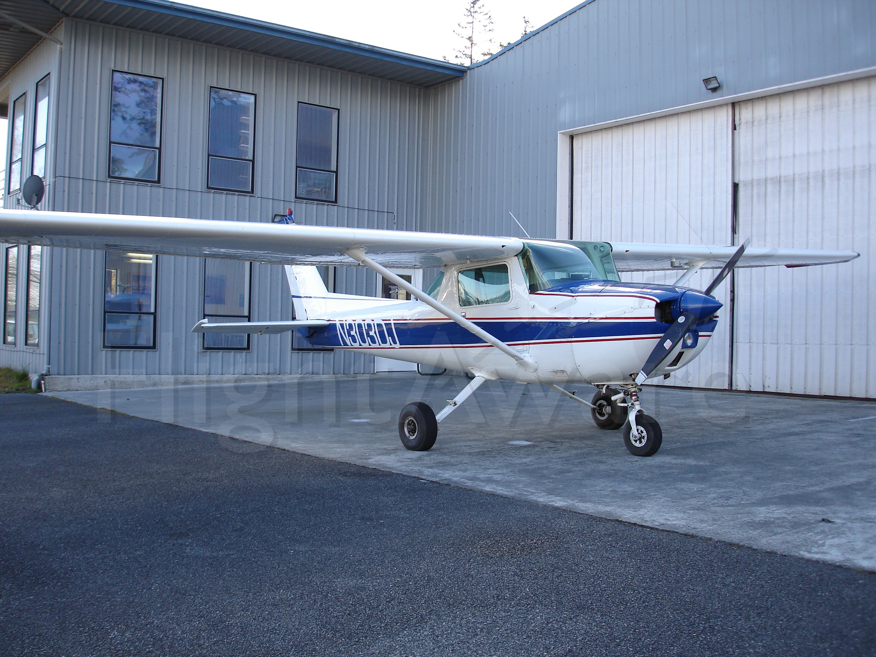 Cessna Commuter (N303DJ) - 1975 Cessna 150M, with 100 hp Continental power.  The tail number represents the March 2003 opening of Westwind Aviation, by owners Daniel and Jen DeShon