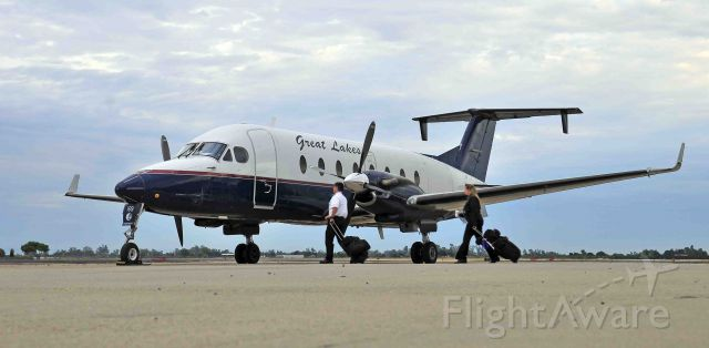 Beechcraft 1900 (N169GL) - Aircrew on their way to work