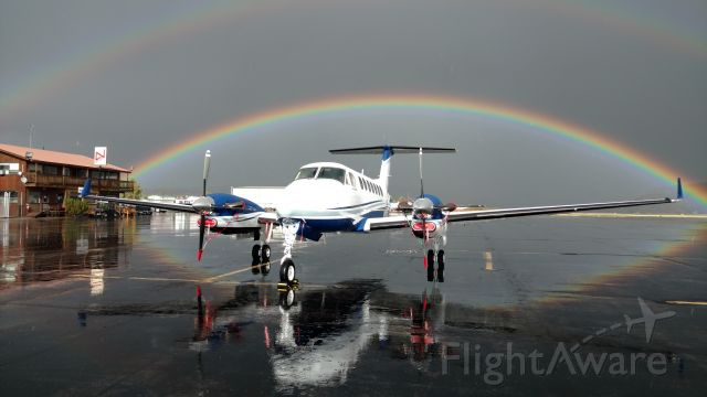 Beechcraft Super King Air 350 (N350GA) - After arriving through a rain shower, these rainbows showed up..