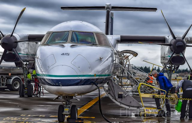 de Havilland Dash 8-400 (N415QX) - Alaska 2030 sitting on the ramp on a typical Seattle day for its flight to Helena