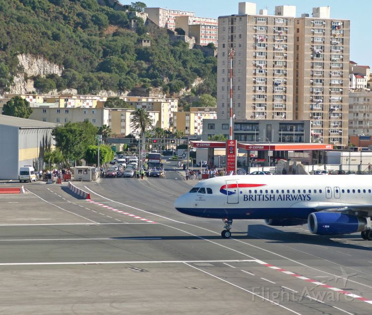 — — - At grade X ing, Gibraltar,  LXGB