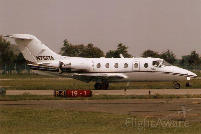 Beechcraft Beechjet (N751TA) - Landing on rwy 19 in Sep-06.  Reregistered N415LX 31-Jan-09 then N440LN 11-Aug-12 and N400TC 5-Sep-14.