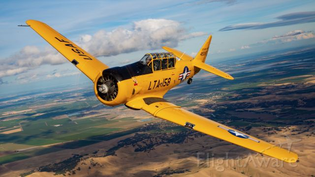 """North American T-6 Texan (N158JZ) - """"Miss Humboldt Hunny"""" over the Sacramento area. Photo credit and thanks to Mike Mainiero for the shot and Nick and Loren for getting this wonderful warbird into position. Additional thanks to the rest of the awesome people that worked on the photoshoot as well. Truly brought to life through the lense!"""