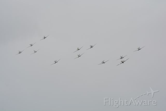 MULTIPLE — - Eleven Spitfires and one Hurricane (lowest at right) on fly by over Goodwood Airpport on 13 Sep 2015