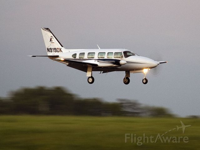 Piper Navajo (N919DK) - A nice crosswind landing on runway 18L, Charlotte, North Carolina, USA. The sun had gone down and this photo was taken in the last light of the day.