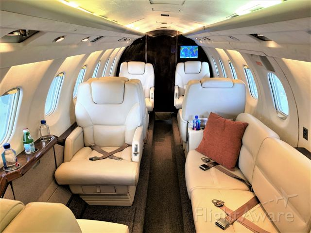 N524LR — - Interior photo of cabin showcasing couch in the back and captain chair at the hangar.