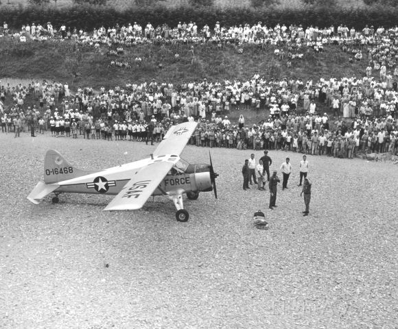 De Havilland Canada DHC-2 Mk1 Beaver (O16468) - USAF L-20 after emergency landing in a riverbed near Osan AFB, Korea - photographed from an H-19 - June 1969