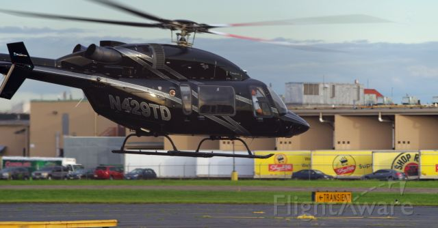 Bell 427 (N429TD) - LINDEN AIRPORT-LINDEN, NEW JERSEY, USA-AUGUST 31, 2020: A helicopter belonging to the New York Helicopter Group is seen taking off from Linden Airport on a morning flight.