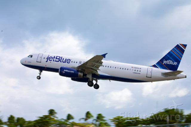 Airbus A320 (N804JB) - Smartly liveried Jet Blue A320 lifting off from Rwy 10 in Sint Maarten - Jan 4, 2013