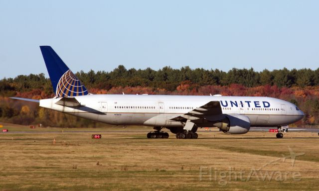 Boeing 777-200 (N78013) - The Denver Broncos Football Team arrives to Bedford Hanscom on 10/17/20 to play the New England Patriots the next day. Possibly the first time a B777 has visited BED.
