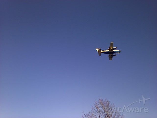 Cessna 421 (N800EE) - Coming in