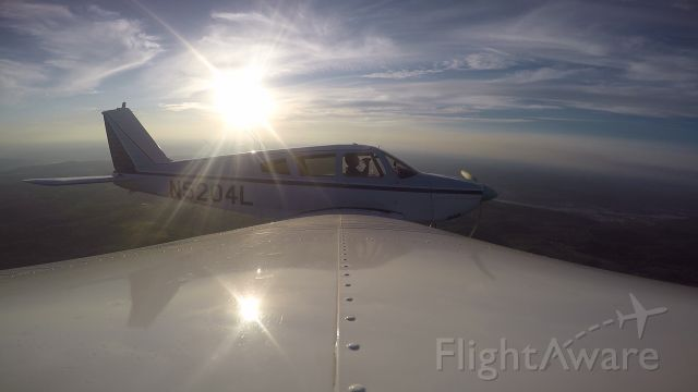 Piper Cherokee (N5204L) - A GoPro picture from the right wing of N5204L over Herron Airport.
