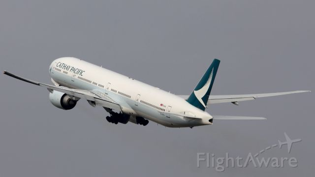 BOEING 777-300ER (B-KPJ) - Cathay leaving Los Angeles in the new livery