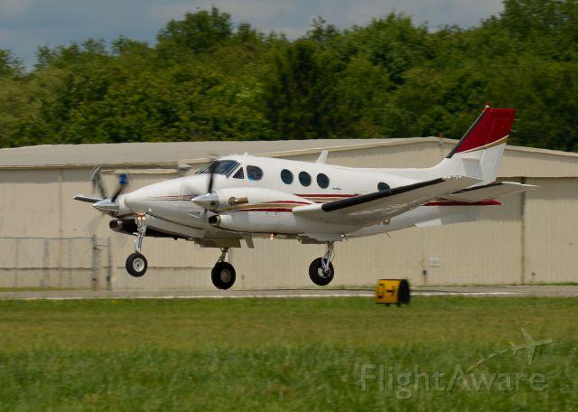 Beechcraft King Air 90 (N127MJ) - Departing Runway 26