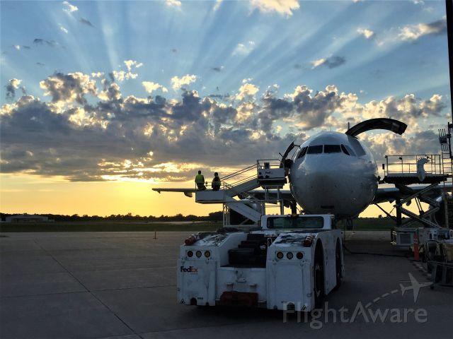 Airbus A300F4-600 (N653FE) - Crepuscular Rays with the Sunset.....<br /><br />Airbus just about ready to be loaded.