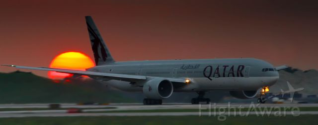 BOEING 777-300ER (A7-BAQ) - Beautiful sunset at the end of runway 10L as QR722 was leaving for Doha.