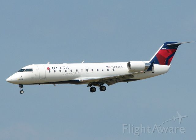 Canadair Regional Jet CRJ-200 (N8836A) - Landing on runway 14 at the Shreveport Regional airport.