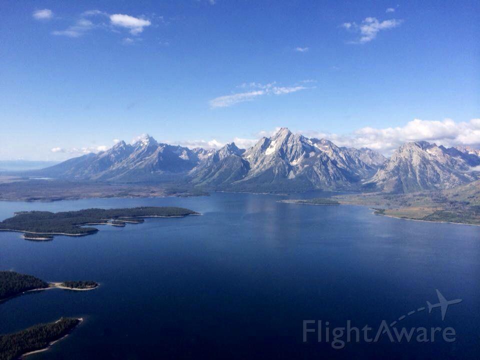 — — - The Tetons flying into KJAC from the north east