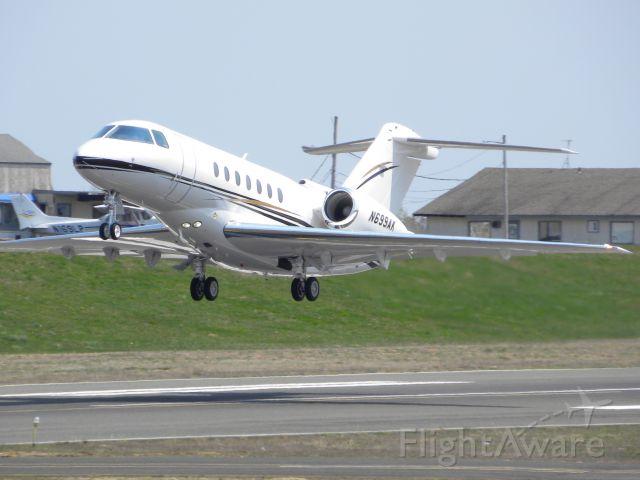 Hawker Beechcraft 4000 (N699AK) - N699AK leaving KBLM on 32