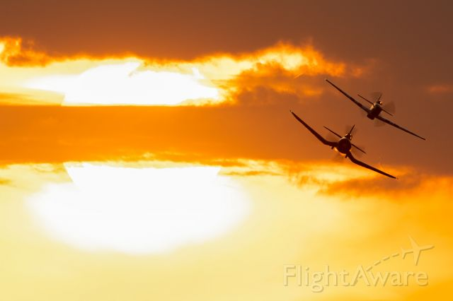 North American P-51 Mustang (N51HY) - The Class of '45 diving in for a beautiful formation pass at sunset. Sun 'N Fun 2021.