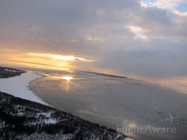 — — - Nice view banking after taking off from Anchorage