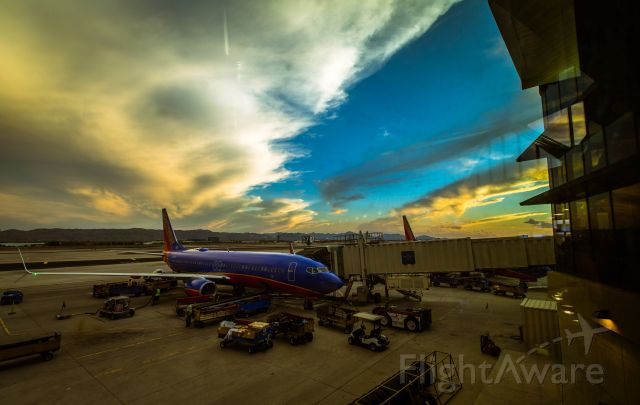 Boeing 737-700 (N8306H) - Standing at the end of the terminal D, beautiful sunset on 14 August 2014