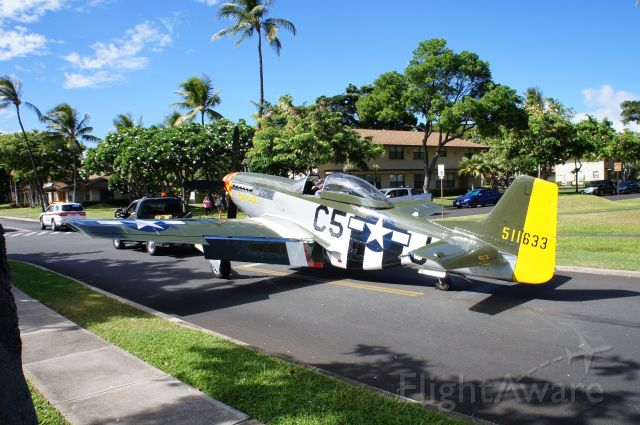 """N151MW — - A P-51D named :Lady Alice"""" being transported from Hickam AFB to Pearl Harbor.  """"Lady Alice"""" was towed with four other WWII era aircraft through the heart of Joint Base Pearl Harbor Hickam (JBPHH) in a most unusual parade through JBPHH housing after spending three weeks on O'ahu while participating in the 75th Anniversary of VJ Day activities.  """"Lady Alice"""" will be loaded onto the USS Essex and shipped back to the mainland."""