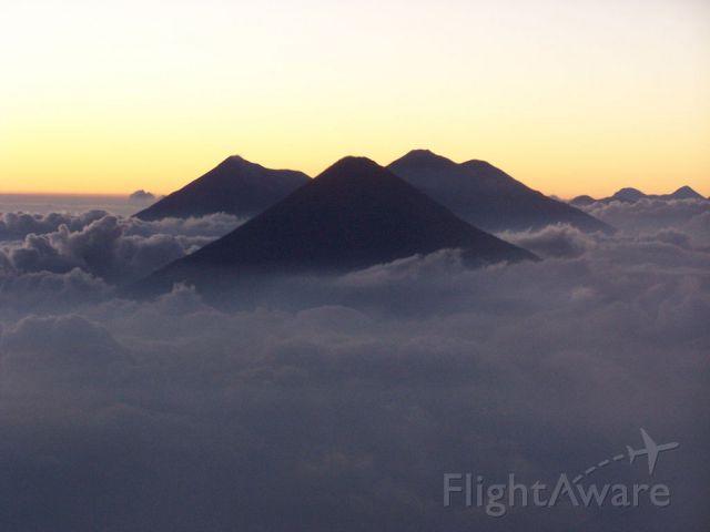 — — - Volcanos near Guatamala City.