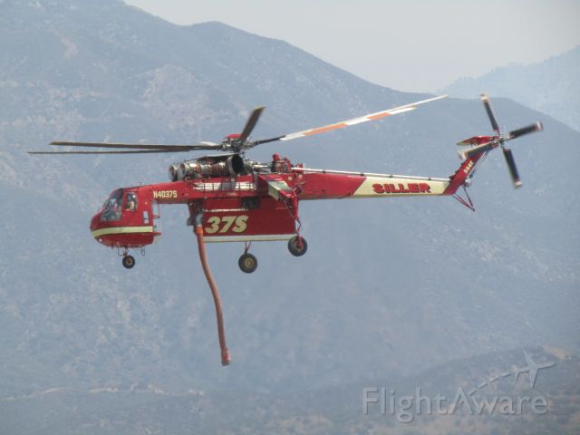 Sikorsky CH-54 Tarhe (N4037S) - Lifting off from KPOC