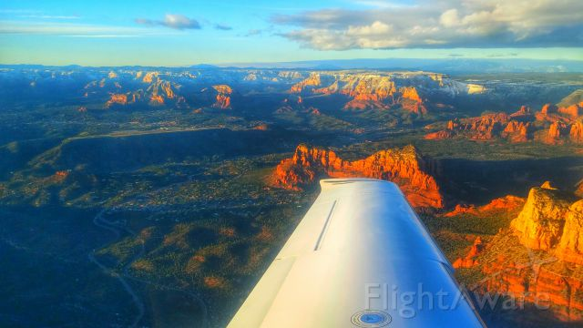 Cirrus SR-22 — - Departing Sedona, Arizona in the early spring with a fresh dusting of snow covering the distant mountains.