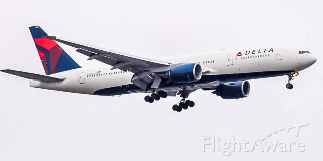 Boeing 777-200 (N860DA) - A Delta 777-232ER approaches runway 21L for Detroit Metropolitan after ferrying over from Atlanta.