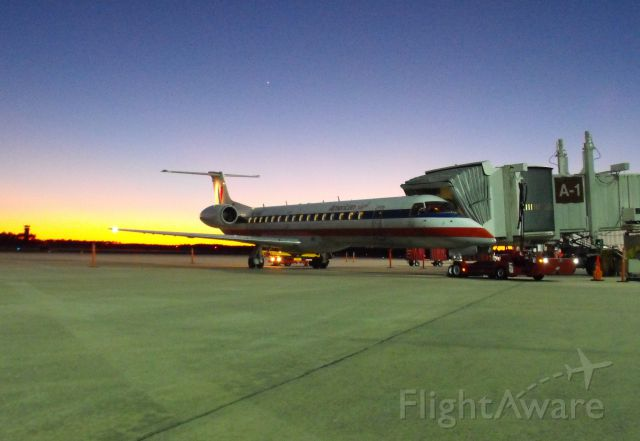 Embraer ERJ-145 (N675AE) - Envoy 3581 getting loaded up to depart for MIA with a nice Florida sunset.