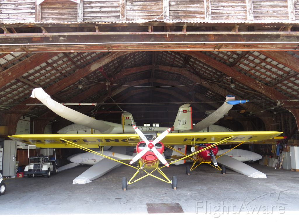 Piper L-21 Super Cub (HB-ORT) - Piper Cub inside the old hangar at Bex used for glider towing. I love the hangars beautiful wooden beams roof structure. This is the original hangar built in 1924 when the Aerodrome was born.