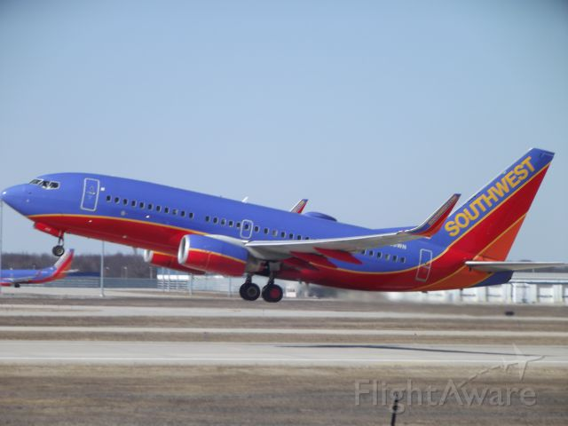 Boeing 737-700 (N436WN) - Departure from 26 left.