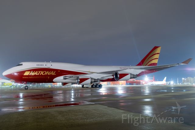 Boeing 747-400 (N936CA) - National's newest 747 sits at SAT's west ramp as she awaits her flight tests before delivery. National made a great decision by keeping the original paint job of her former role as the Global Supertanker while adding their own touches.